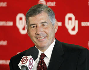 Photo - Big 12 Commissioner Bob Bowlsby smiles as he answers a question during an NCAA college football news conference in Norman, Okla., Monday, Aug. 27, 2012. (AP Photo/Sue Ogrocki) ORG XMIT: OKSO105