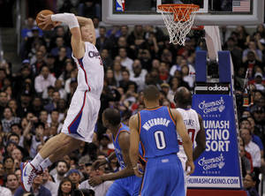 Photo - Los Angeles Clippers power forward Blake Griffin dunks against the Oklahoma City Thunder during the second half of an NBA basketball game in Los Angeles, Monday, Jan. 30, 2012. (AP Photo/Chris Carlson)
