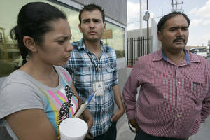 Photo -   Family members, from left, Myrna Ramirez, Cesar De La Fuente and Homero De La Fuente,47, father and brother of Manuel Homero De La Fuente, 19, a Pemex worker who is still missing after the gas explosion on Tuesday, wait to hear word of their loved one at the PGR facility in Reynosa, Mexico, Wednesday, Sept .19, 2012. (AP Photo/The Monitor, Delcia Lopez)