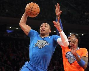 Photo - Dec 25, 2013; New York, NY, USA; Oklahoma City Thunder point guard Russell Westbrook (0) drives past New York Knicks shooting guard Iman Shumpert (21) during the first quarter of a game at Madison Square Garden. Mandatory Credit: Brad Penner-USA TODAY Sports