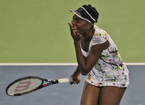 Photo - Venus Williams of the U.S. reacts after she missed a ball to Elena Vesnina of Russia during the first round of Dubai Duty Free Tennis Championships in Dubai, United Arab Emirates, Monday, Feb. 17, 2014. (AP Photo/Kamran Jebreili)