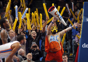Photo - Oklahoma City fans try to distract San Antonio players during the NBA basketball game between the Oklahoma City Thunder and the San Antonio Spurs at the Chesapeake Energy Arena in Oklahoma City, Sunday, Jan. 8, 2012. Photo by Sarah Phipps, The Oklahoman