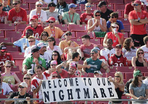 Photo - Tampa Bay Buccaneers fans show their displeasure with the team during the fourth quarter of an NFL football game against the Philadelphia Eagles Sunday, Oct. 13, 2013, in Tampa, Fla. The Eagles defeated the Buccaneers 31-20. (AP Photo/Chris O'Meara)