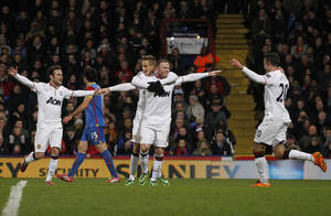 Photo - Manchester United's Wayne Rooney, center right, celebrates his goal against Crystal Palace with teammates during their English Premier League soccer match at Selhurst Park, London, Saturday, Feb. 22, 2014. (AP Photo/Sang Tan)