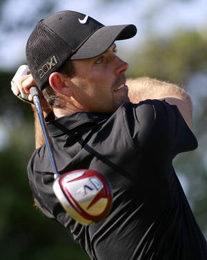 Photo - Charl Schwartzel of South Africa plays a shot off the second tee during the second round of the British Open Golf Championship at Muirfield, Scotland, Friday July 19, 2013. (AP Photo/Peter Morrison)