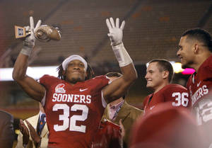 Photo - Oklahoma's Jamell Fleming (32) celebrates the Sooner's win in the Insight Bowl college football game between the University of Oklahoma (OU) Sooners and the Iowa Hawkeyes at Sun Devil Stadium in Tempe, Ariz., Friday, Dec. 30, 2011. Photo by Sarah Phipps, The Oklahoman