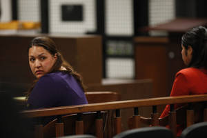 Photo - Candace Marie Brito, left,  and co-defendant Vanesa Zavala  sit in court during their preliminary hearing at  the West Justice Center in Westminster, Calif. Monday  Feb. 10, 2014. Brito and Zavala are facing charges in the beating death of Kim Pham in front of a Santa Ana nightclub.  (AP PHOTO/LOS ANGELES TIMES, Mark Boster, Pool )