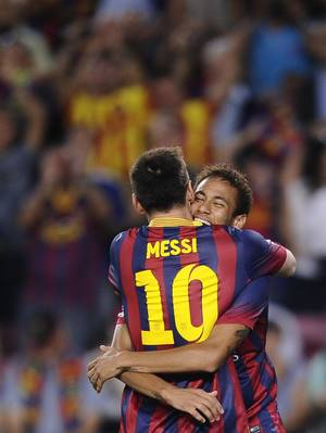 Photo - FC Barcelona's Neymar, from Brazil, right, celebrates after scoring against Real Sociedad with teammate Lionel Messi, from Argentina, during a Spanish La Liga soccer match at the Camp Nou stadium in Barcelona, Spain, Tuesday, Sept. 24, 2013. (AP Photo/Manu Fernandez)