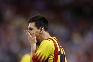 Photo - FC Barcelona Lionel Messi from Argentina reacts during a Spanish Supercup, first leg soccer match against Atletico de Madrid's at the Vicente Calderon stadium,  in Madrid, Spain, Wednesday, Aug. 21, 2013. (AP Photo/Daniel Ochoa de Olza)