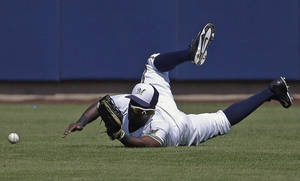 Photo - Milwaukee Brewers' Elian Herrera cannot catch a ball hit by San Diego Padres' Xavier Nady during the first inning of an exhibition spring training baseball game on Friday, March 7, 2014, in Phoenix. (AP Photo/Morry Gash)
