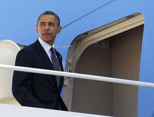 Photo -   President Barack Obama prepares to board Air Force One before his departure from Andrews Air Force Base, Md.,Thursday, May, 10, 2012. Obama is traveling to the West Coast for a series of campaign fundraisers. (AP Photo/Pablo Martinez Monsivais)