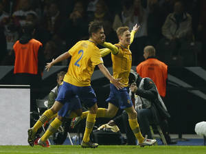 photo -   Sweden's Rasmus Elm, right, celebrates after scoring during the World Cup 2014 Group C qualifying soccer match between Germany and Sweden in Berlin, Germany Tuesday, Oct. 16, 2012. (AP Photo/Frank Augstein)