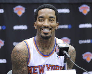 Photo - New York Knicks' J.R. Smith talks to the media at the NBA teams media day Monday, Sept. 30, 2013, in Greenburgh, N.Y. (AP Photo/Bill Kostroun)