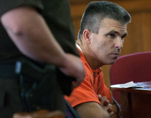 Photo - Former major league baseball player Chad Curtis appears in court for his sentencing on Thursday, Oct. 3, 2013, in Hastings, Mich. Curtis was sentenced Thursday to seven to 15 years in prison for inappropriately touching teenage girls. (AP Photo/The Grand Rapids Press- MLive.com, Chris Clark)