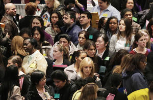 Photo - FILE - In this Thursday, March 14, 2013, file photo, a crowd of job seekers attends a healthcare job fair, in New York. The government reports on JOLTS -- the Job Openings and Labor Turnover Survey -- for March on Tuesday, May 7, 2013. (AP Photo/Mark Lennihan)