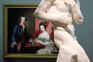 """Photo - Francis Cotes' painting named """"Portrait of William Welby and his wife Penelope Playing Chess"""" (1769) and Antonio Canova's sculpture named """"The Pugilists Creugas and Damoxenos"""" (1797-1803) are displayed as part of the exhibition """"Louvre Abu Dhabi. Birth of a Museum"""", at the Louvre museum, in Paris, Monday, April 28, 2014. The Louvre Abu Dhabi, the Persian Gulf's first ever world museum, will open its doors in December 2015 in the arid Arab federation. Several thousand kilometers away on Tuesday the Louvre in Paris previewed the art that the Abu Dhabi project has acquired since 2009 for the first time to a European audience. (AP Photo/Thibault Camus)"""
