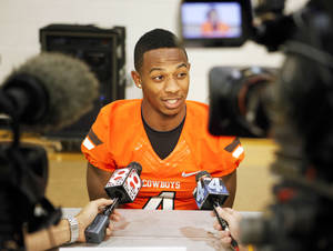 Photo - Oklahoma State cornerback Justin Gilbert speaks with reporters at the Oklahoma State football media day held at Gallagher-Iba Arena in Stillwater on August 3, 2013. KT King, For The Oklahoman