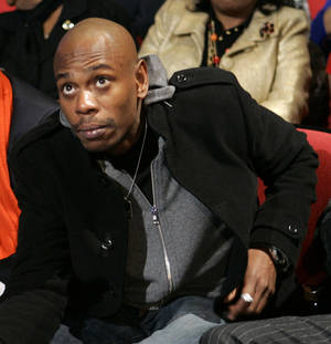"""Photo - FILE - In this Monday, Jan. 21, 2008, file photo, comedian Dave Chappelle attends the Democratic presidential debate sponsored by CNN and the Congressional Black Caucus Institute, in Myrtle Beach, S.C. Chappelle says he never quit his Comedy Central show. He's just seven years late to work. Chappelle appeared on """"The Late Show With David Letterman"""" on Tuesday, June 10, 2014, his first late-night appearance in more than six years. Chappelle has kept a mostly low-profile since abruptly exiting """"Chappelle's Show"""" in 2005. The 40-year-old comic begins a string of stand-up performances at Radio City Music Hall next week. (AP Photo/Charles Rex Arbogast, File)"""