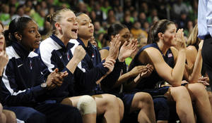 Photo - The Connecticut bench reacts to a play in the third overtime of an NCAA college basketball game against Notre Dame, Monday, March 4, 2013, in South Bend, Ind. Notre Dame won 96-87. (AP Photo/Joe Raymond)