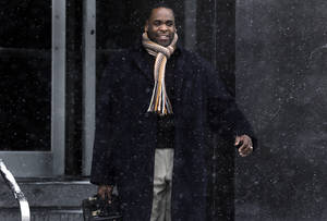 Photo - Former Detroit Mayor Kwame Kilpatrick leaves federal court in Detroit, Friday, Jan. 25, 2013. Kilpatrick will spend this weekend in prison as a penalty for 14 parole violations, a state spokesman said Friday. Kilpatrick is to report to the Detroit Reentry Center Friday afternoon and will be released from custody early Monday. (AP Photo/Paul Sancya)