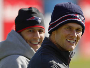 Photo -   New England Patriots quarterback Tom Brady, right, and tight end Aaron Hernandez walk onto the practice field for a walk through at the team's NFL football training facility in Foxborough, Mass., Wednesday, Oct. 17, 2012. (AP Photo/Stephan Savoia)
