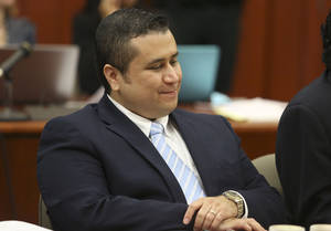 Photo - George Zimmerman smiles as attorney Mark O'Mara questions potential jurors for Zimmerman's trial in Seminole circuit court in Sanford, Fla., Thursday, June 20, 2013. Zimmerman has been charged with second-degree murder for the 2012 shooting death of Trayvon Martin. (AP Photo/Orlando Sentinel, Gary Green, Pool)