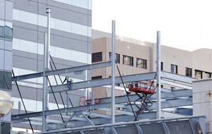 Photo -  Steel beams are going up on an expansion to the City Center parking garage at Park and Harvey Avenues. More than 1,600 spaces are being added to alleviate a parking shortage downtown.  <strong>PAUL B. SOUTHERLAND -  PAUL B. SOUTHERLAND </strong>
