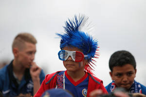 Photo - A young France soccer supporter waits for the arrival of the national soccer team players, at Le Bourget airport, north of Paris, Sunday, July 6, 2014. France were defeated 0-1 by Germany in a Soccer World Cup quarterfinal match on Friday. (AP Photo/Thibault Camus)