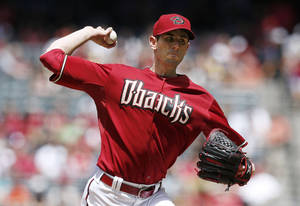Photo - Arizona Diamondbacks' Brandon McCarthy throws a pitch against the Philadelphia Phillies during the first inning of a baseball game on Sunday, April 27, 2014, in Phoenix. (AP Photo/Ross D. Franklin)