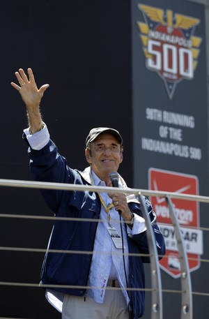 "Photo - Jim Nabors waves to fans after singing ""(Back Home Again in) Indiana"" for the final time before the start of the 98th running of the Indianapolis 500 IndyCar auto race at the Indianapolis Motor Speedway in Indianapolis, Sunday, May 25, 2014. (AP Photo/Michael Conroy)"