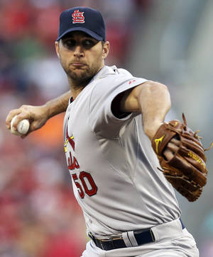 Photo - St. Louis Cardinals starting pitcher Adam Wainwright throws against the Cincinnati Reds in the first inning of a baseball game, Sunday, May 25, 2014, in Cincinnati. (AP Photo/Al Behrman)