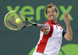 Photo - Richard Gasquet, of France, returns a shot from Andy Murray, of Great Britain, during a semifinal match at the the Sony Open tennis tournament on Friday, March 29, 2013, in Key Biscayne, Fla. (AP Photo/Wilfredo Lee)