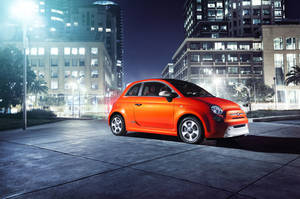 "Photo - This undated image provided by Fiat shows the 2013 Fiat 500e mini-car, which will be appearing at the Los Angeles Auto Show this week. The ""500e"" is the brand's first all-electric model in the U.S. while the ""500L"" comes with four doors and significantly more room than a regular model. The first 500 hit U.S. showrooms two years ago, promising a stylish and fuel-efficient remake of the 1950s original. But the car needs to boost its allure in the U.S., where sales remain pint-sized compared with the rest of the world. (AP Photo/Fiat)"
