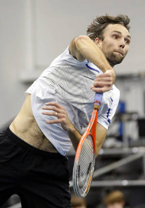 Photo - Ivo Karlovic, of Croatia, hits a return to Jack Sock in the quarterfinal match at the U.S. National Indoor Tennis Championships, Friday, Feb. 14, 2014, in Memphis, Tenn. (AP Photo/Rogelio V. Solis)
