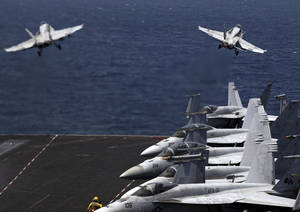 Photo - U.S. F/A-18 fighter jets take off for mission in Iraq from the flight deck of the U.S. Navy aircraft carrier USS George H.W. Bush, in the Persian Gulf, Monday, Aug. 11, 2014. U.S. military officials said American fighter aircraft struck and destroyed several vehicles Sunday that were part of an Islamic State group convoy moving to attack Kurdish forces defending the northeastern Iraqi city of Irbil. (AP Photo/Hasan Jamali)
