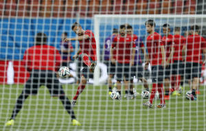 Photo - Switzerland soccer players practise shooting during a training session at the Arena da Amazonia in Manaus, Brazil, Tuesday, June 24, 2014, one day before the group E match between Honduras and Switzerland of the 2014 soccer World Cup. (AP Photo/Frank Augstein)