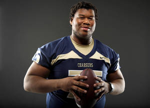 Photo - HIGH SCHOOL FOOTBALL: All-State football player Markus Wakefield, of Heritage Hall, poses for a photo in Oklahoma CIty, Wednesday, Dec. 14, 2011. Photo by Bryan Terry, The Oklahoman