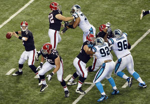 Photo -   FILE - In this Sept. 30, 2012, filephoto, Atlanta Falcons quarterback Matt Ryan (2) is well protected as he looks for a receiver during the first half of an NFL football game against the Carolina Panthers in Atlanta. Ryan is the NFL's top-rated passer, guiding the Falcons to an unbeaten record and a commanding lead in the NFC South. (AP Photo/Rich Addicks, File)