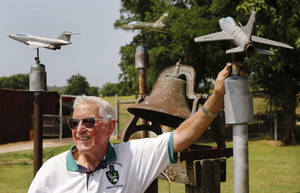 Photo - Ken McDaniel, a 78 year-old Air Force veteran, has a few hobbies including making metal replicas of military aircraft he, family or friends have flown.  <strong>Jim Beckel - THE OKLAHOMAN</strong>
