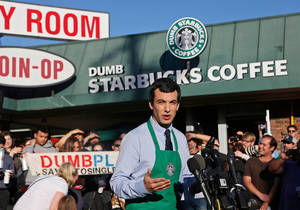"Photo - Canadian comedian Nathan Fielder of the Comedy Central show ""Nathan For You"" comes forward as the brainchild of ""Dumb Starbucks,"" a parody store that resembles a Starbucks with a green awning and mermaid logo, but with the word ""Dumb"" attached above the Starbucks sign. Starbucks Coffee spokeswoman, Laurel Harper says the store is not affiliated with Starbucks and, despite the humor, the store cannot use the Starbucks name. (AP Photo/Nick Ut)"