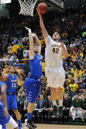 Photo - North Dakota State's Marshall Bjorklund goes up for a shot over Indiana-Purdue-Fort Wayne's Jordan Aaberg during the second half of an NCAA college basketball game for the Summit League men's tournament title, Tuesday, March 11, 2014, in Sioux Falls, S.D. North Dakota State won 60-57. (AP Photo/Argus Leader, Jay Pickthorn) NO SALES