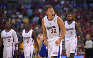 Photo - Los Angeles Clippers forward Blake Griffin, second from right, tries to fire up fans as Chris Paul, left, Darren Collison, second from left, and DeAndre Jordan look on during the second half in Game 1 of an opening-round NBA basketball playoff series, Saturday, April 19, 2014, in Los Angeles. The Warriors won 109-105. (AP Photo/Mark J. Terrill)