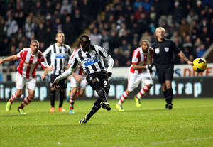 Photo - Newcastle United's Papiss Cisse, cente, scores his goal from a penalty kick during their English Premier League soccer match against Stoke City at St James' Park, Newcastle, England, Thursday, Dec. 26, 2013. (AP Photo/Scott Heppell)