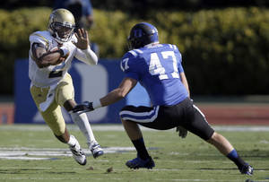 Photo - Duke's David Helton (47) moves in to tackle Georgia Tech's Vad Lee during the first half of an NCAA college football game in Durham, N.C., Saturday, Sept. 14, 2013. (AP Photo/Gerry Broome)