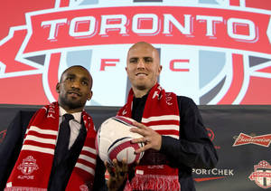 Photo - New Toronto FC soccer players Jermain Defoe, left, and Michael Bradley pose during a news conference in Toronto, Monday, Jan. 13, 2014. (AP Photo/The Canadian Press, Frank Gunn)
