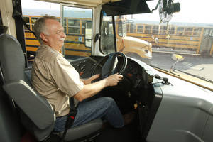 Photo - Left: Trainee Mark  English practices  maneuvering a school bus Thursday at the Oklahoma City Public Schools Transportation Department. Oklahoma City Public Schools needs bus drivers, and school starts soon.  Photos By Paul Hellstern,  The Oklahoman
