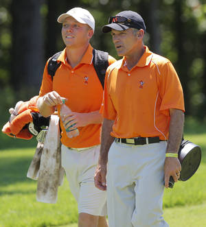 Photo - COLLEGE GOLF / NCAA GOLF TOURNAMENT: OSU coach Mike McGraw, right, talks with Talor Gooch during the team match semifinals of the NCAA Division I Men's Golf Championship at Karsten Creek in Stillwater, Okla., Saturday, June 4, 2011. Oklahoma State University lost the match play semifinal to Augusta State.  Photo by Nate Billings, The Oklahoman ORG XMIT: KOD