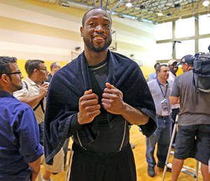 Photo - Miami Heat's Dwyane Wade smiles after team practice at American Airlines Arena in Miami on Friday, May 3, 2013. (AP Photo/El Nuevo Herald, Al Diaz)  MAGS OUT NO SALES