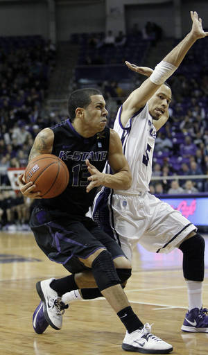 photo - Kansas State guard Angel Rodriguez (13) drives against TCU sophomore guard Kyan Anderson (5) during the first half of an NCAA college basketball game on Wednesday, Jan. 16, 2013, in Fort Worth, Texas. (AP Photo/Brandon Wade)