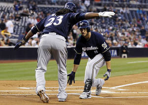 Photo - Milwaukee Brewers' Ryan Braun, right, is congratulated by Rickie Weeks (23) after hitting a two-run home run against the San Diego Padres in the first inning of a baseball game, Monday, April 22, 2013, in San Diego. (AP Photo/Alex Gallardo)